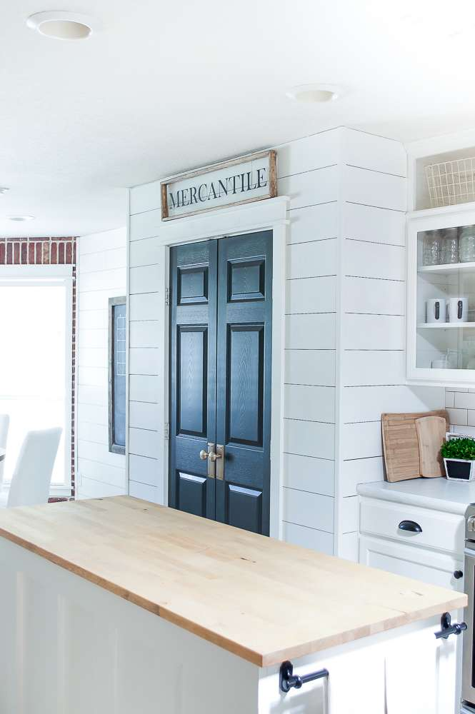 farmhouse style kitchen makeover looking towards pantry