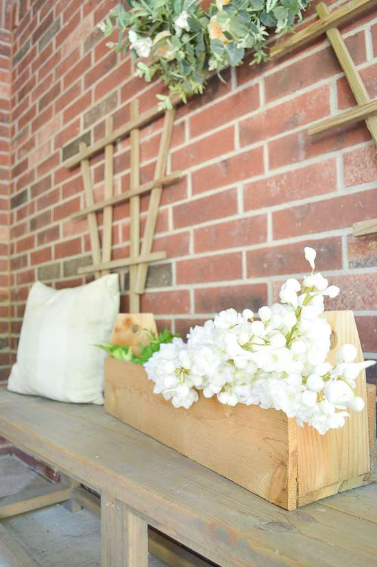 summer porch and entryway tour snapdragons in carpenter's toolbox
