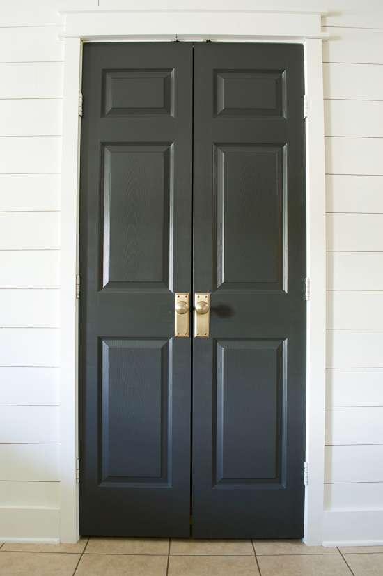 black pantry doors / Sherwin-Williams Iron Ore painted door